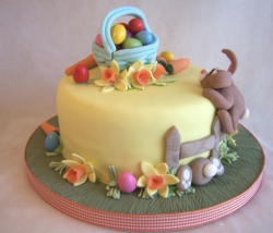 Yellow easter cake with bunny cake decors.PNG