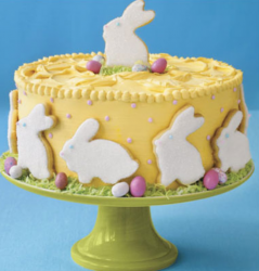 Yellow Easter cake with bunny cake toppers.PNG
