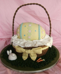 Easter basket with a gaint yellow cake easter egg.PNG