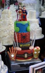 Superhero theme 4 tier Wedding Cake with Superman & Wonder Woman Bride Groom toppers.JPG