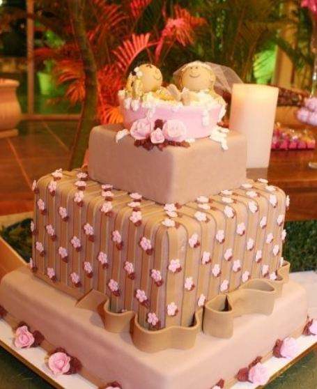 Chocolate 3 tier square wedding cake with bride and groom in a bathtub as topper.JPG