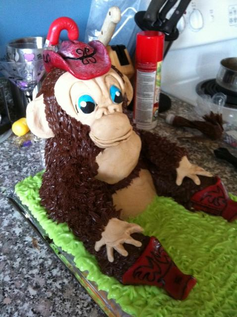 Cake of a monkey sitting in grass.jpg