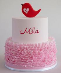 Two tier round elegant modern white first birthday cake with pink ruffles and red bird on top for girl.JPG