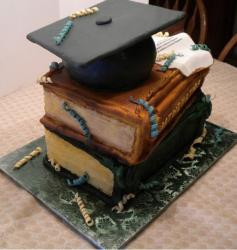Two tier graduation cake with 2 thick volumns of textbooks and graduation cap on top.JPG