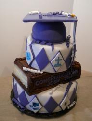 3 tier graduation cake with thick textbook as second tier and graducation cap on top.JPG