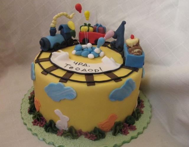 Round yellow birthday cake for toddler with railroad track and trains and animals.JPG