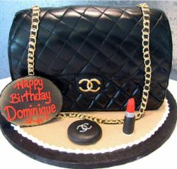 Black Chanel handbag cake with lipstick.JPG