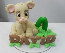 Sculpted baby lion first birthday cake for boy.JPG
