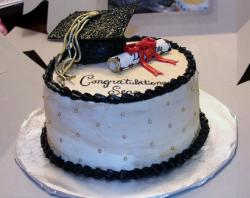 Round Graduation Cake with Cap Pearls & Diploma wrapped in Red Bow.JPG