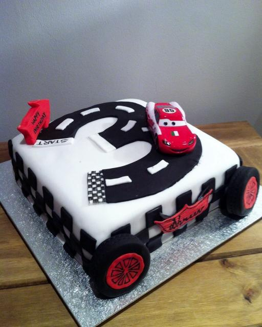 Lightning McQueen Cars 3rd Birthday Cake with track shaped like number three.JPG