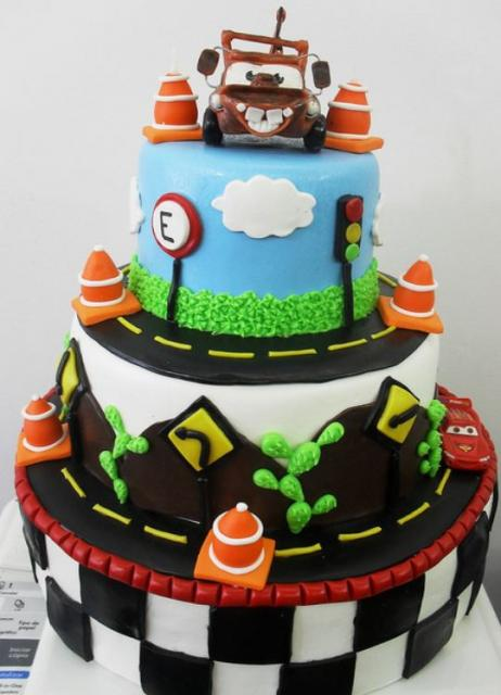 3 tier Cars theme cake with Mater on top.JPG
