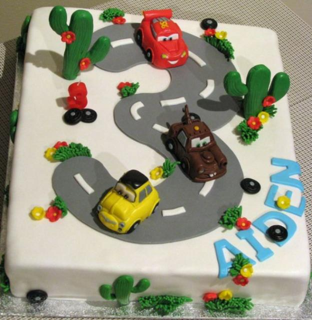 White square Cars Cake for 3 year old with the number 3 as a road along with Luigi, Lightning McQueen and Mater.JPG