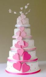 5 tier round white wedding cake with heart theme.JPG