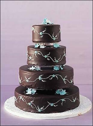 Rich Dark Choccake Wedding Cake With Blue Flowers