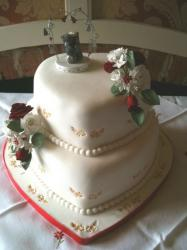 2 tier heart shaped wedding cake with pearl strings.JPG