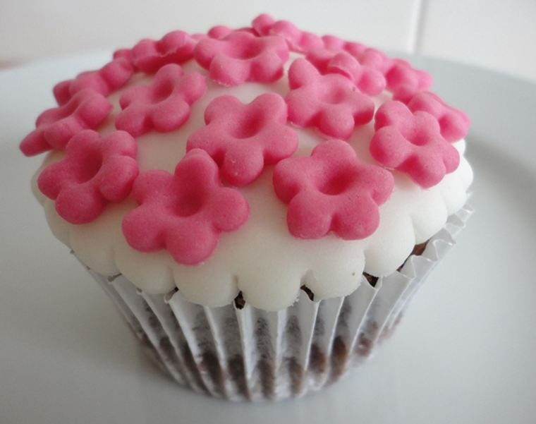 Chocolate cupcake with pink stars on top.JPG