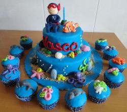 Cool blue two tier ocean and diving theme birthday cake with matching cupcakes.JPG