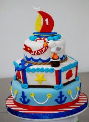 Seafaring theme 3 tier first birthday cake with sailboat on top.JPG