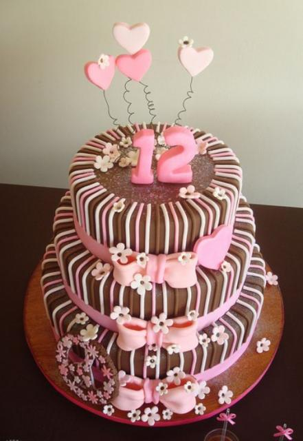 Three tier chocolate birthday cake with pink 12 and hearts on top.JPG