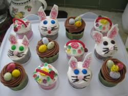 Easter theme cupcakes including bunny and eggs.JPG
