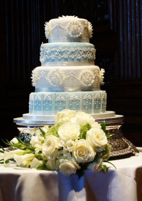 4 Tier Round Wedding Cake With Floral Decor And Angel
