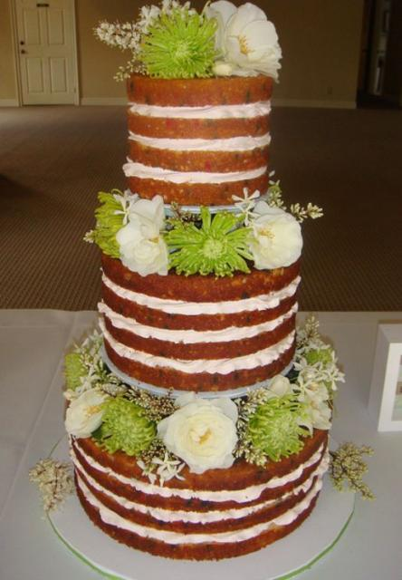 wedding cake with flowers in between layers three tier multi layered wedding cake with fresh 26882
