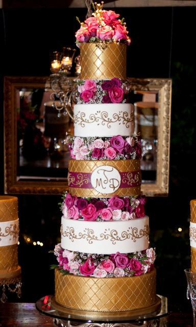 White Wedding Cake Fresh Flowers And Gold