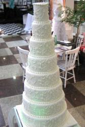 8 tier round white wedding cake with pearl beads.JPG