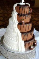 5 tier round chocolate wedding cake with white traditional cover on half of cake.JPG