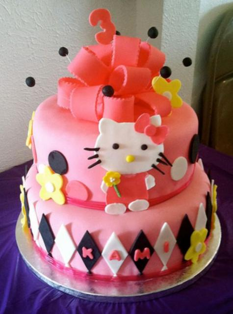 2 tier pink Hello Kitty cake with bow on top for 3-year-old.JPG