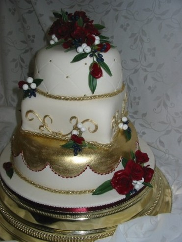 wedding cakes in gold and red flowers