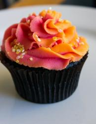 Chocolate cupcake with red and orange cream on top.JPG