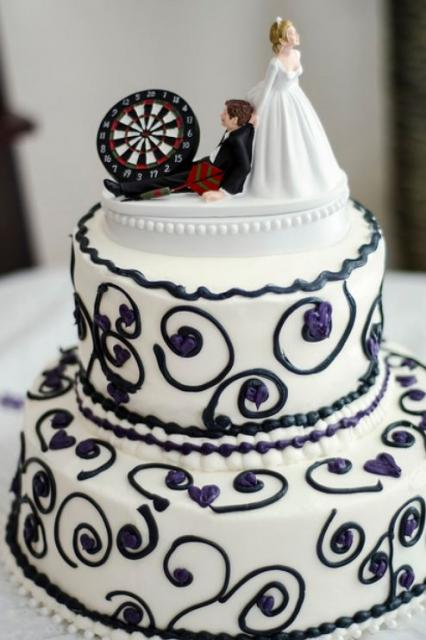 Dual tier round white wedding cake with dart theme humorous bride and groom topper.JPG
