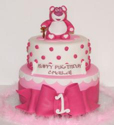 2 tier pink round first birthday cake with large bow and pink teddy bear on top.JPG