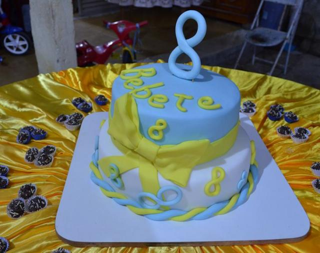 2 Tier Blue And White Round Birthday Cake With Yellow Bow For 8 Year