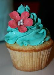 Cupcake with blue cream and pink flower.JPG