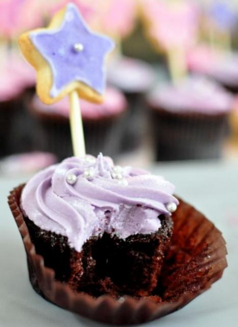 Chocolate cup cake with lavender cream and star on a stick.JPG