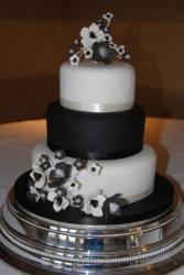 3 tier black and white wedding cake with black and white flowers.JPG