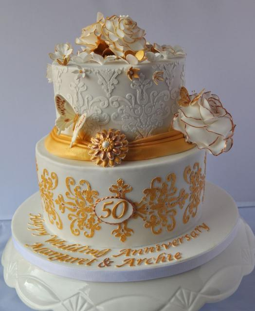 2 tier round white 50th anniversary cake with butterflies and gold accent.JPG
