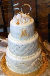 Round white 3 tier 50th wedding anniversary cake with monogram and the number 50 as topper.JPG