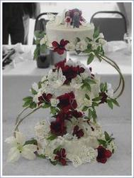 butterfly wedding cake with red flowers