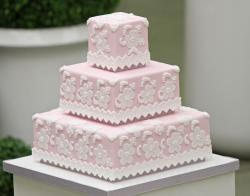 Pink square 3 tier baby girl shower cake with white flowers.JPG