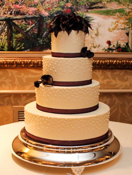 wedding cakes 4 tier round 4 tier white wedding cake with black flowers on top jpg 23754
