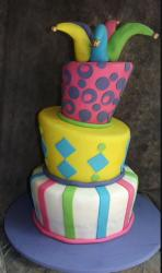 3 tier topsy turvy cake with jester hat extensions on top.JPG