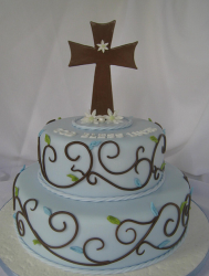 Traditional cake design with two tiers in baby blue and brown and cross cake topper.PNG