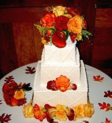 wedding cake with bright color roses