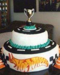 2 tier Hot Wheels theme cake with trophy cup on top.JPG