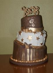 Three tier chocolate and cream grad cake.JPG