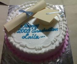 Graduation cake with cap and diploma.JPG