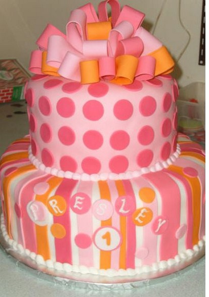 Pink and orange birthday cake with ribbon on top.jpg